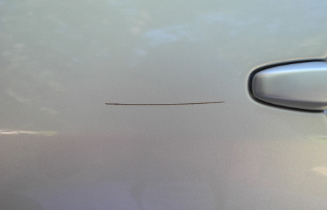 Mazda scratch removal (before) by ACME Mobile Detail